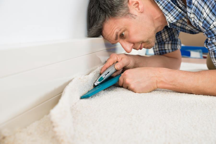 Professional carpet Fitter Laying a carpet as an example of our carpet fitting service Burton on Trent