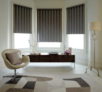 3 windows in a modern lounge with blinds as an example of Out Custom Made to Measure Blinds – Burton on Trent