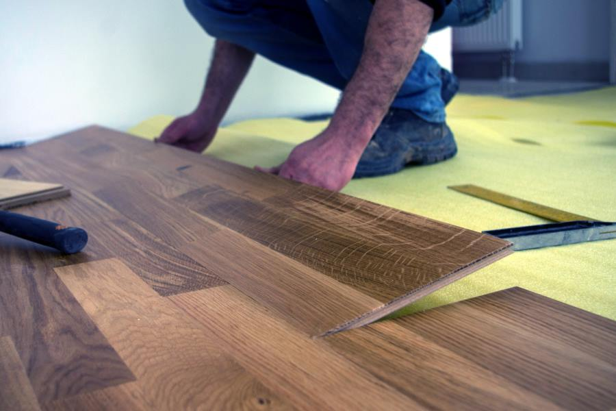 Professional Laminate Flooring Fitter in Burton on Trent laying a new laminate floor