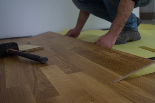 Professional Laminate Flooring Tradesman fitting laminate floor in a Burton on Trent home